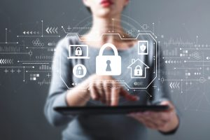 Security theme with business woman using a tablet computer